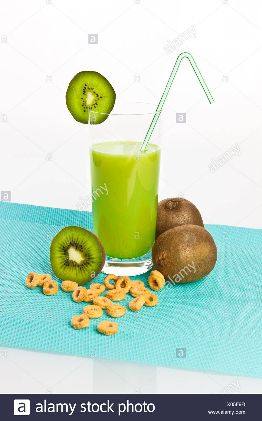 Kiwi fruit drinking yoghurt, kiwi shake in a glass with kiwi fruit and cereals - Stock Image
