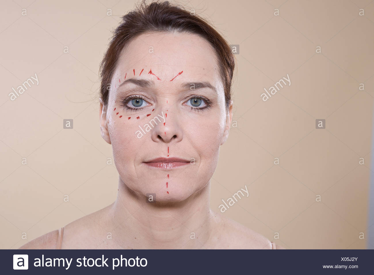 Woman's face with marks for a cosmetic surgery Stock Photo