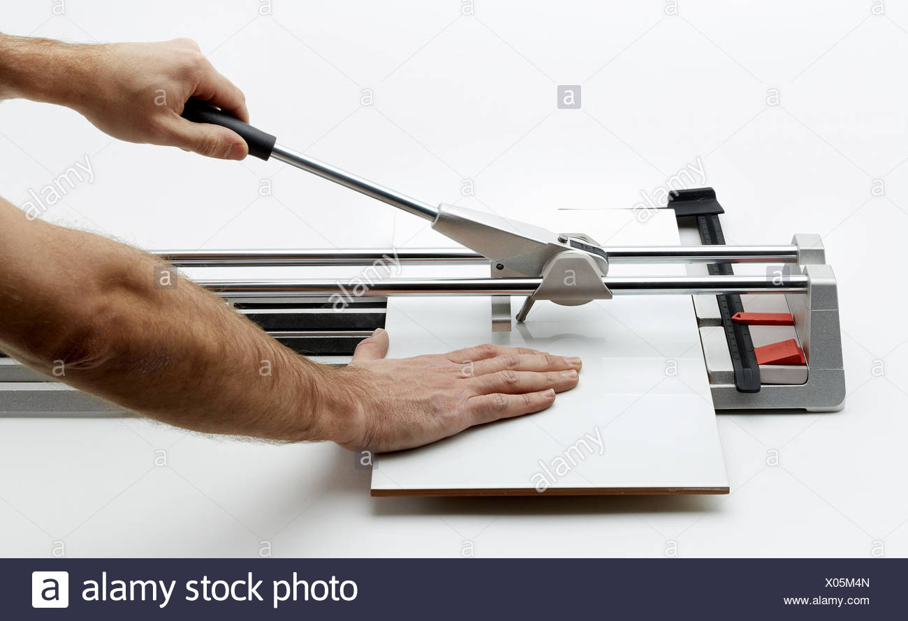Manual tile cutter. Cutting tile. Construction Industry. - Stock Image