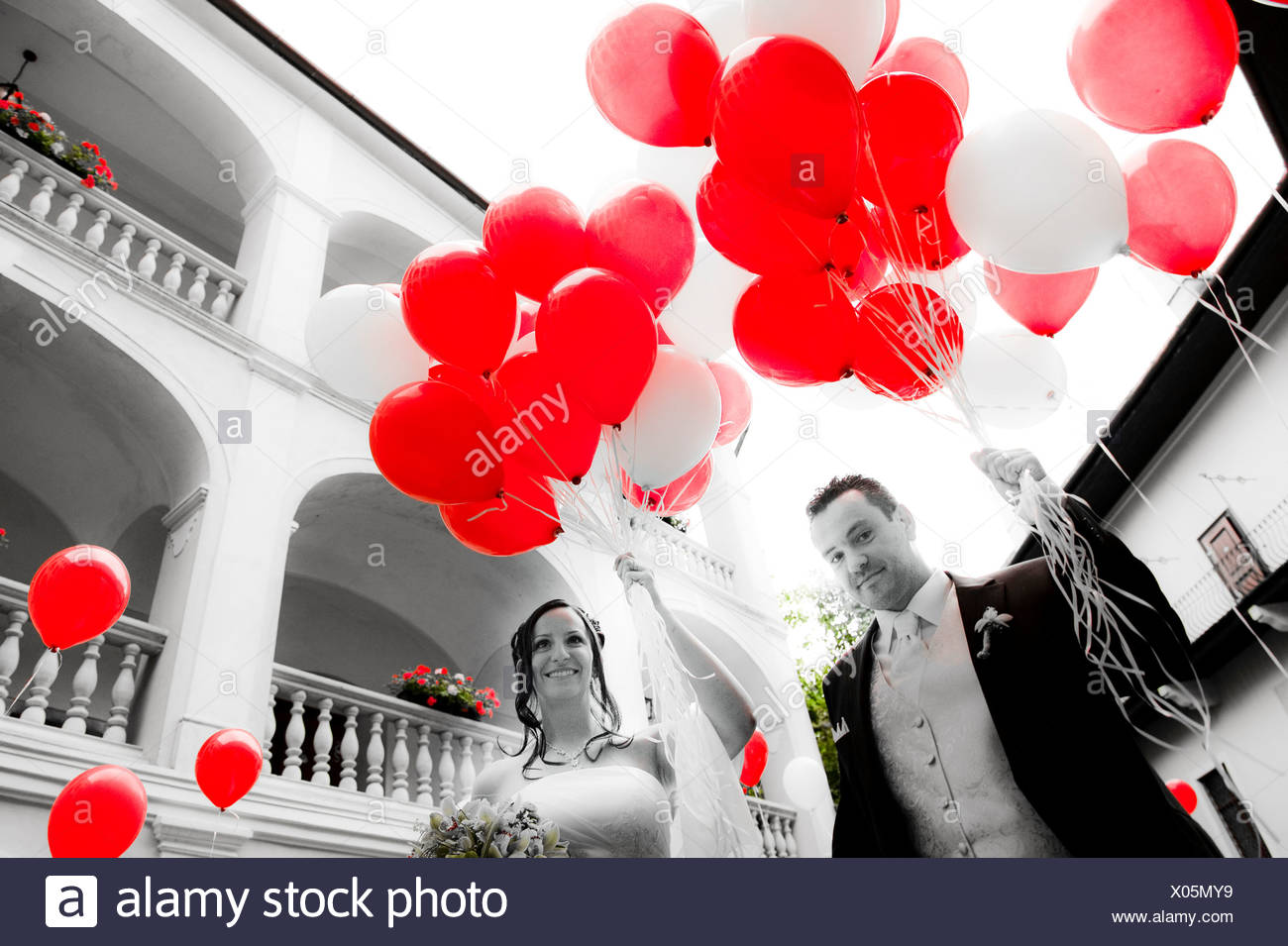 bridal couple with red balloons Stock Photo