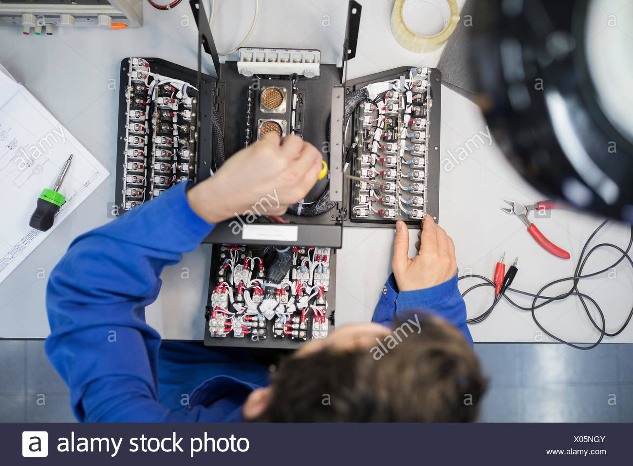 Overhead view helicopter technician working on module - Stock Image