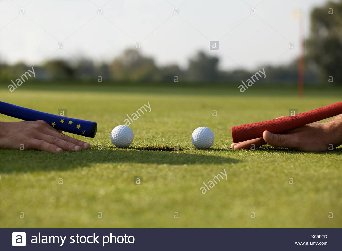 Human hands using golf balls to play pool - Stock Image