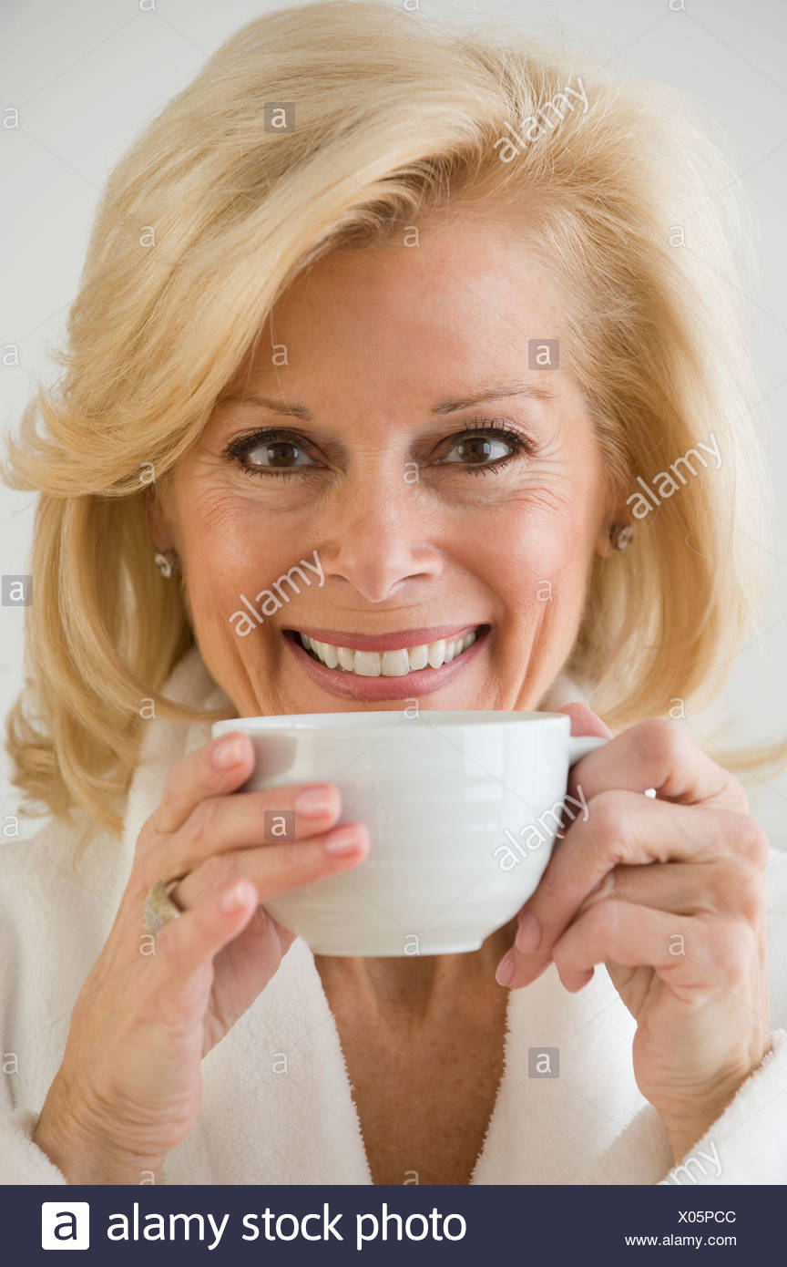 Senior woman drinking coffee - Stock Image