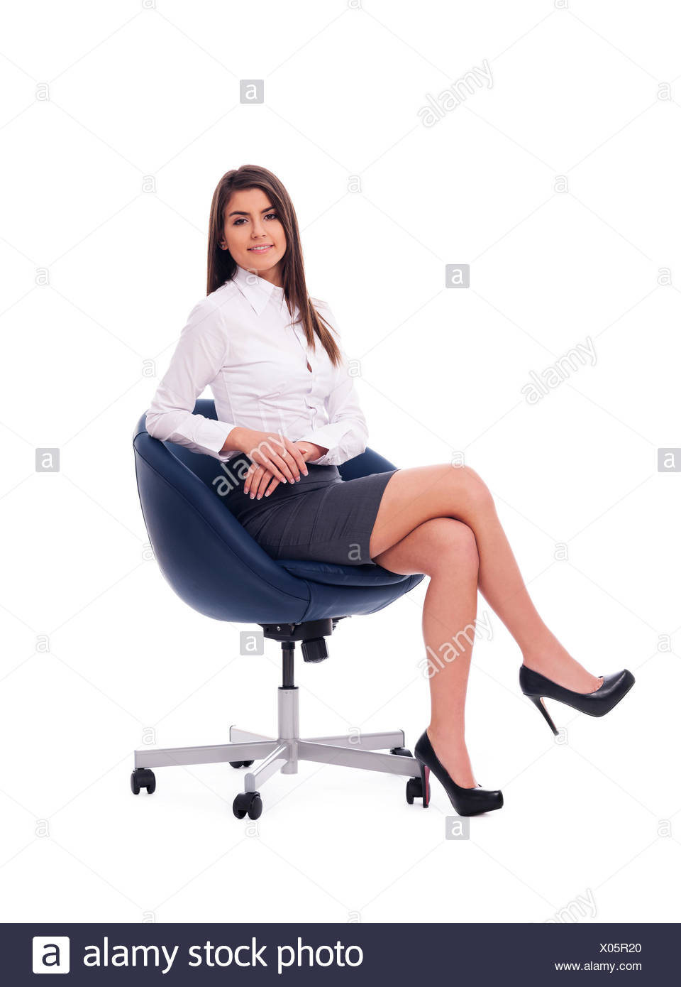 Beautiful businesswoman sitting on a chair, Debica, Poland - Stock Image