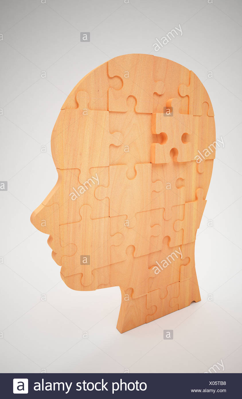 wooden puzzles forming a shape of human head Stock Photo