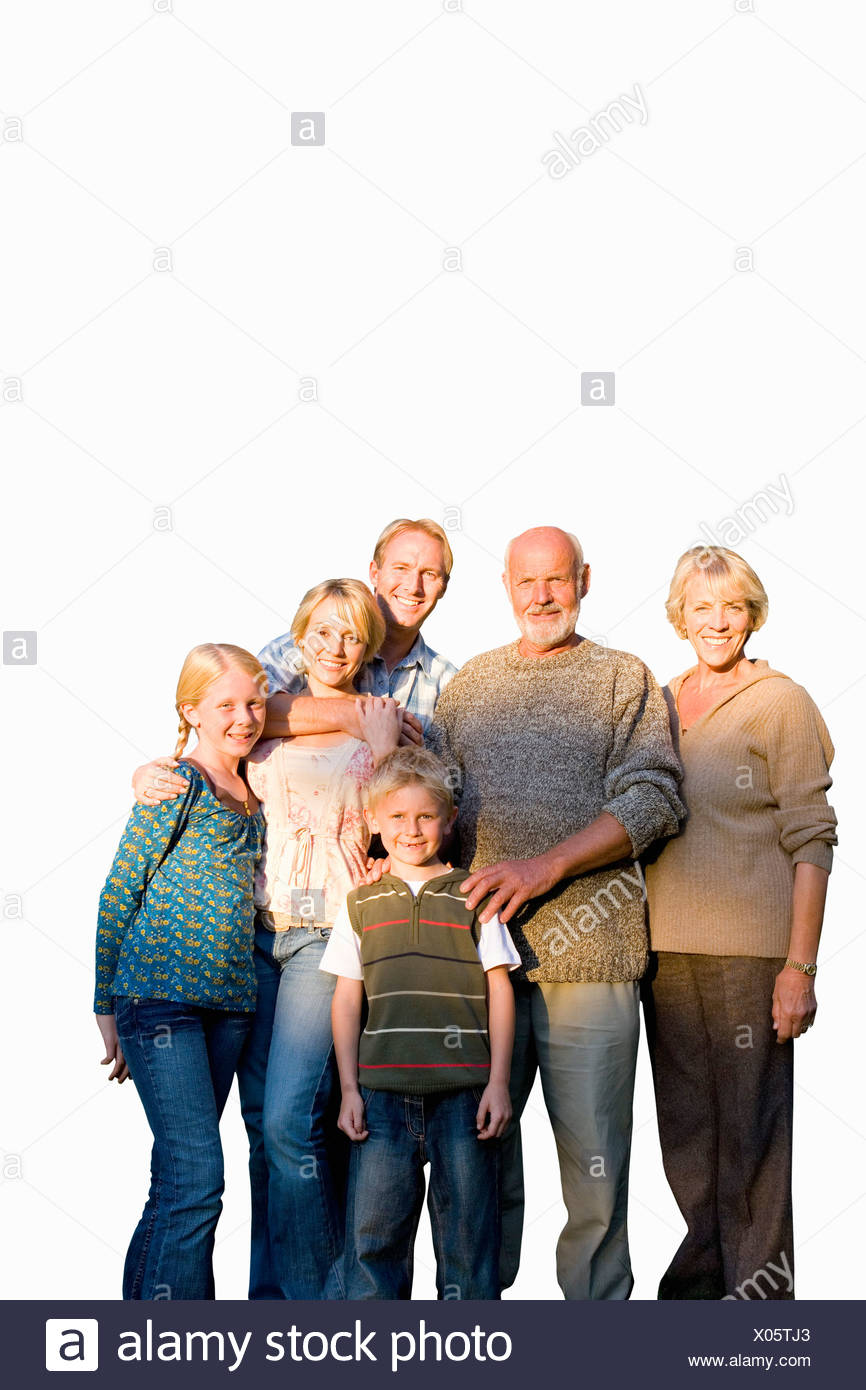 Family of three generations arm in arm, smiling, portrait, cut out - Stock Image