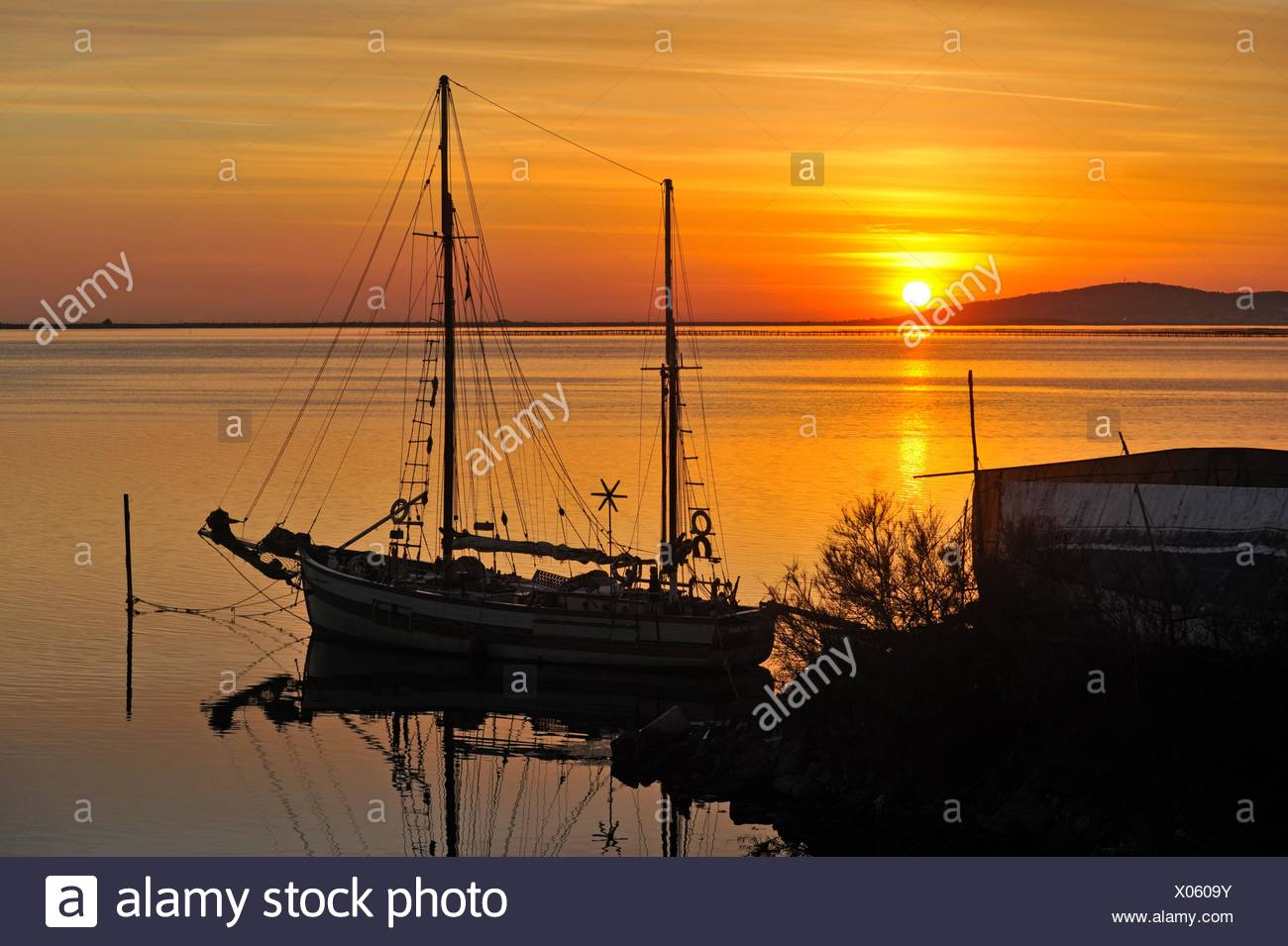 ketch sailing boat at anchor on Etang de Thau, Marseillan, Herault department, Languedoc-Roussillon region, France, Europe. - Stock Image