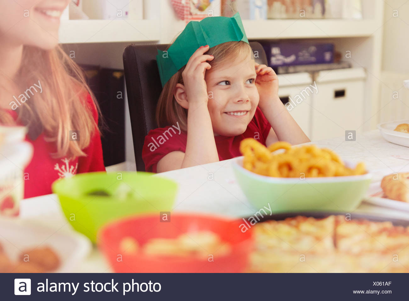 769b97b36f817 Children wearing paper crowns at christmas Stock Photo  275498679 ...