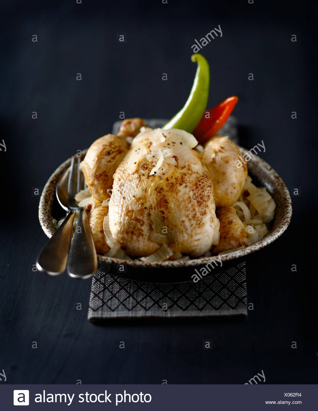 Roast chicken with lime and onions - Stock Image