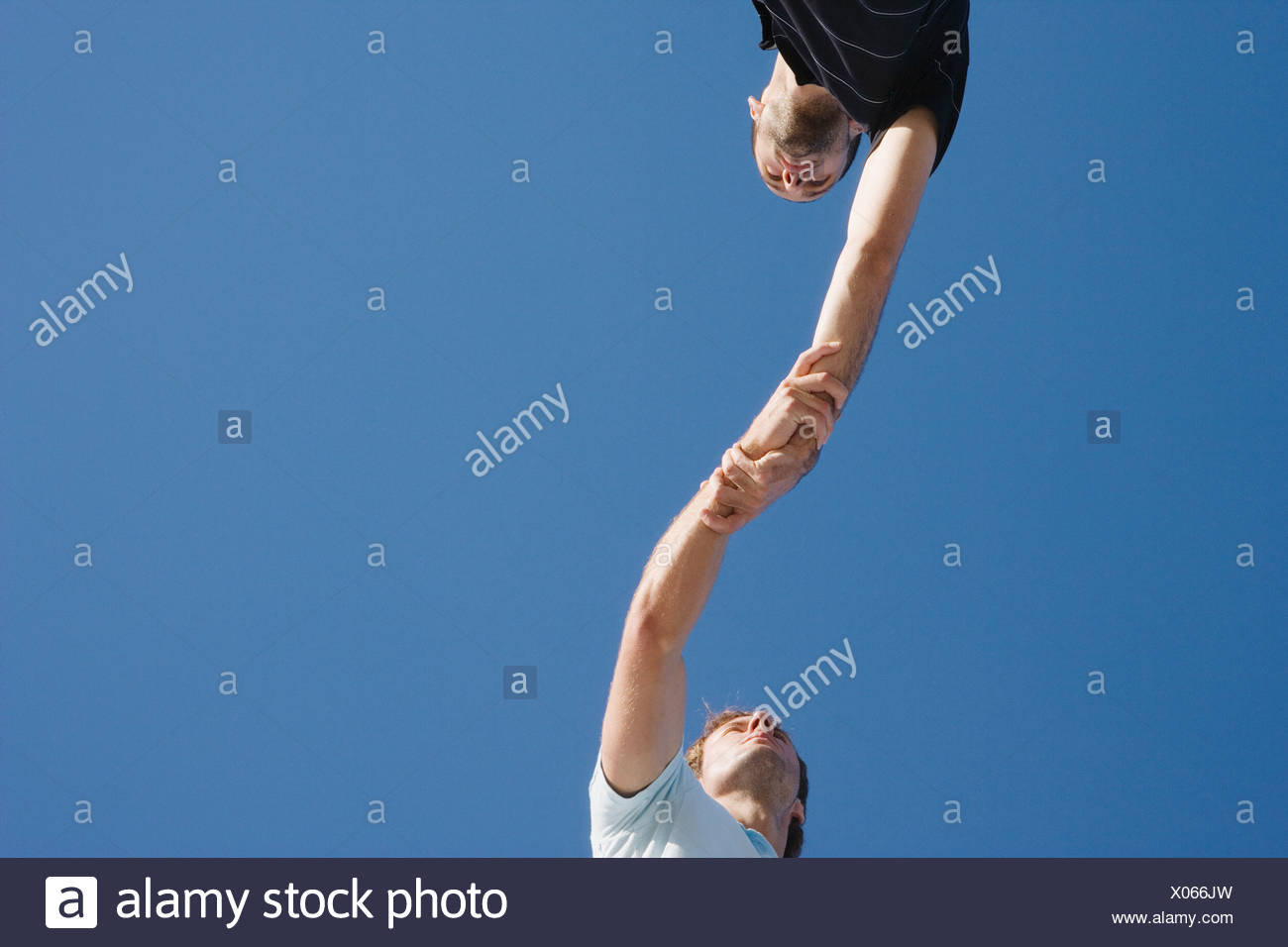 Two men holding each others arms - Stock Image