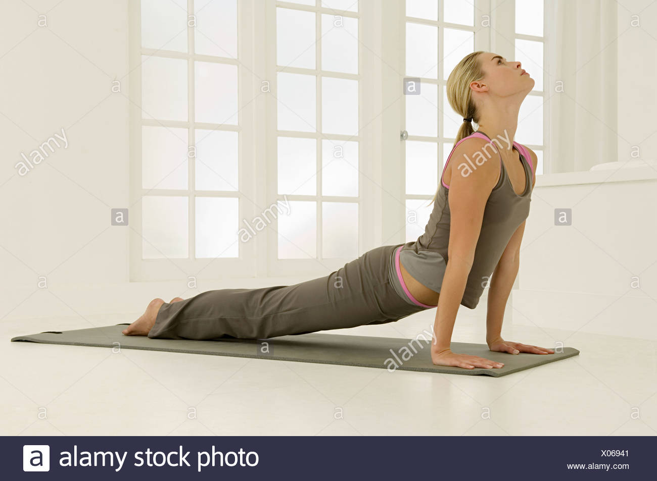 Woman in cobra pose - Stock Image