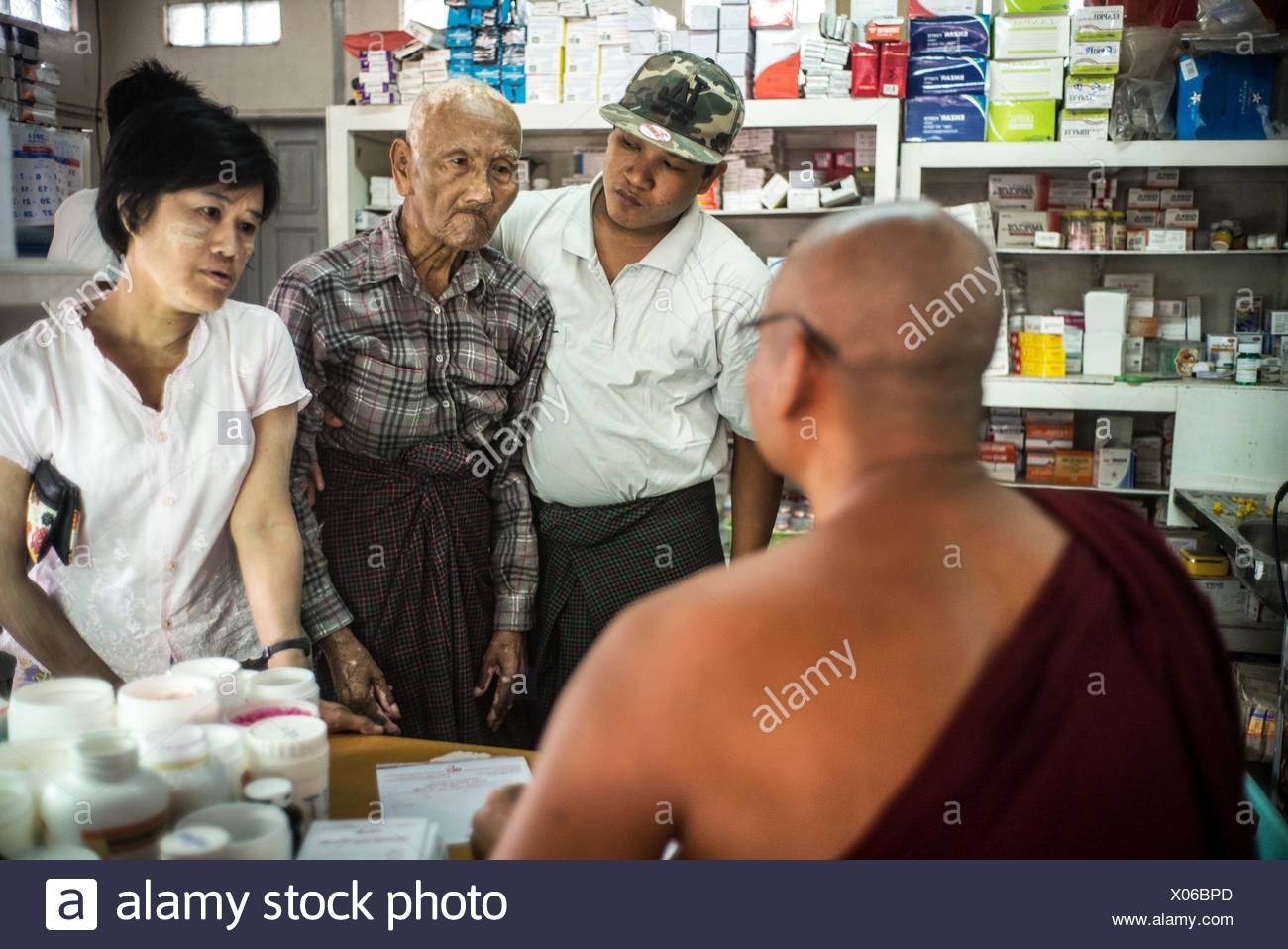 A group of people waiting at a clinic. - Stock Image