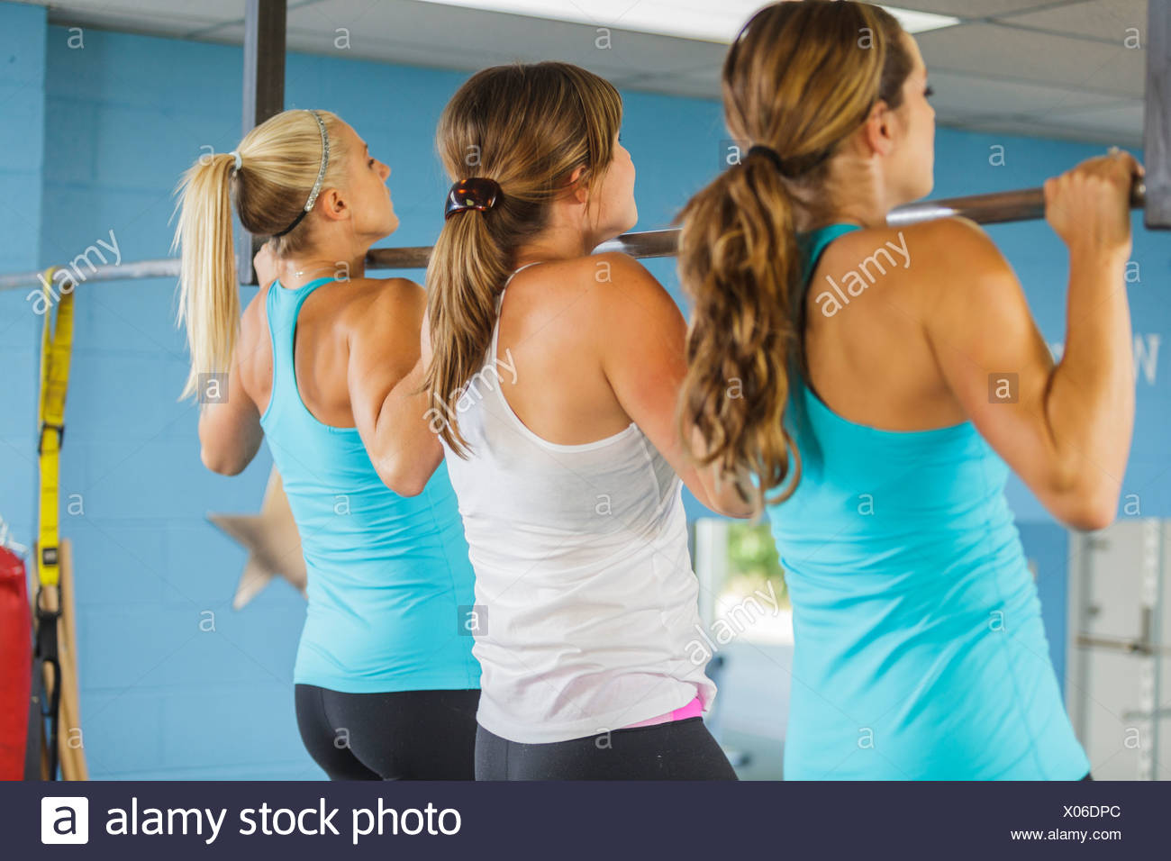 Personal trainers at work in a private workout studio. - Stock Image
