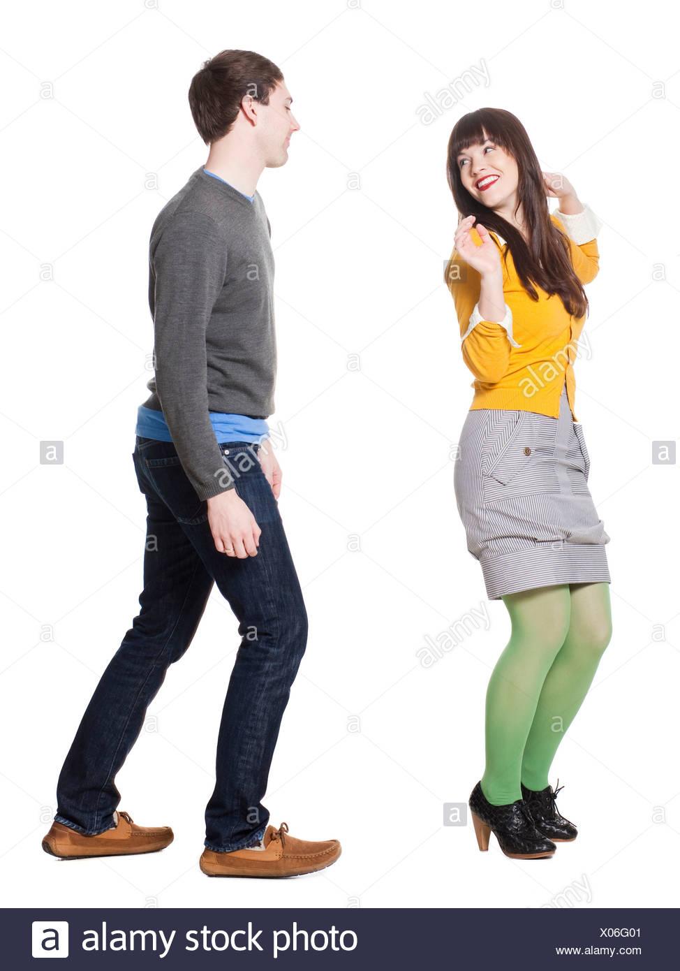 Young couple dancing, studio shot - Stock Image