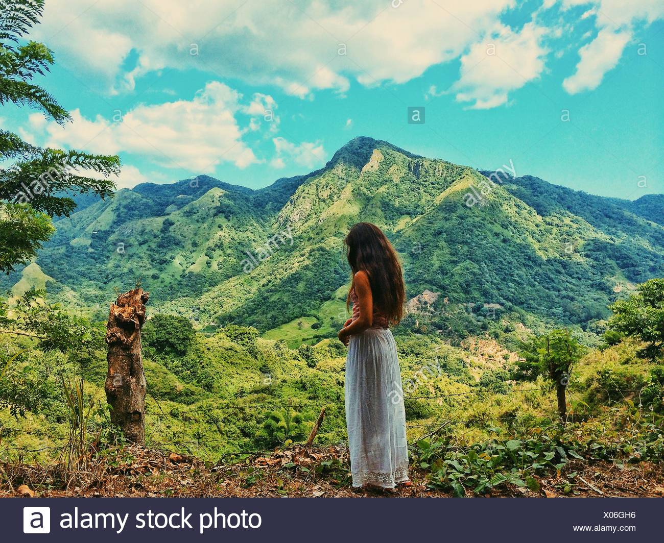 Woman with mountain in background - Stock Image