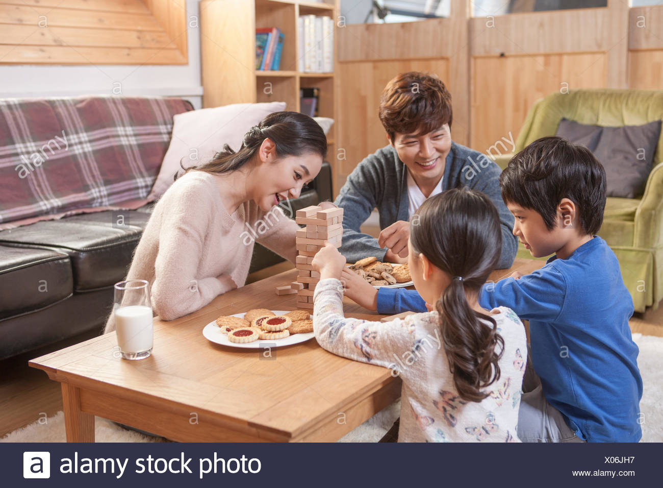 Harmonious family eating cookies together - Stock Image