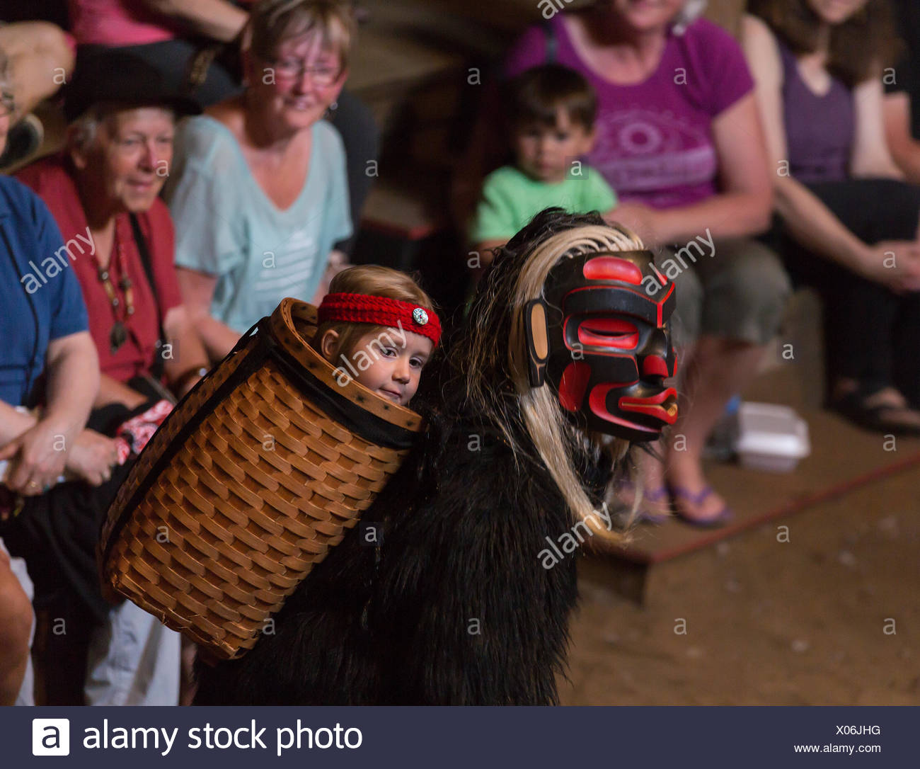 Dzunakwa, Wild woman of the woods and the keeper of children in first nation lore dances for visitors to the Komok's bighouse, Comox, Vancouver Island, British Columbia, Canada. - Stock Image