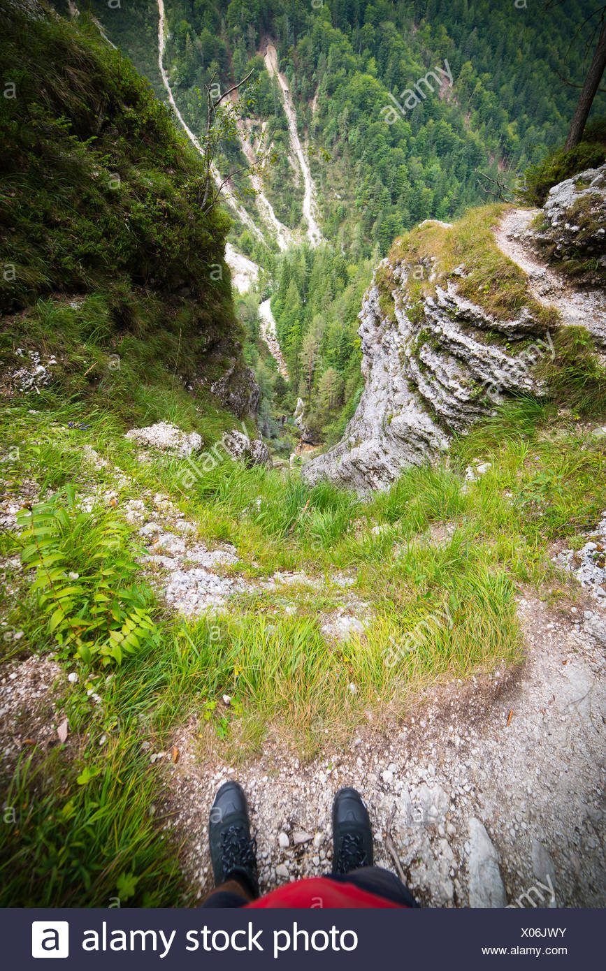 A man over deep void in Julian Alps in Slovenia - Stock Image