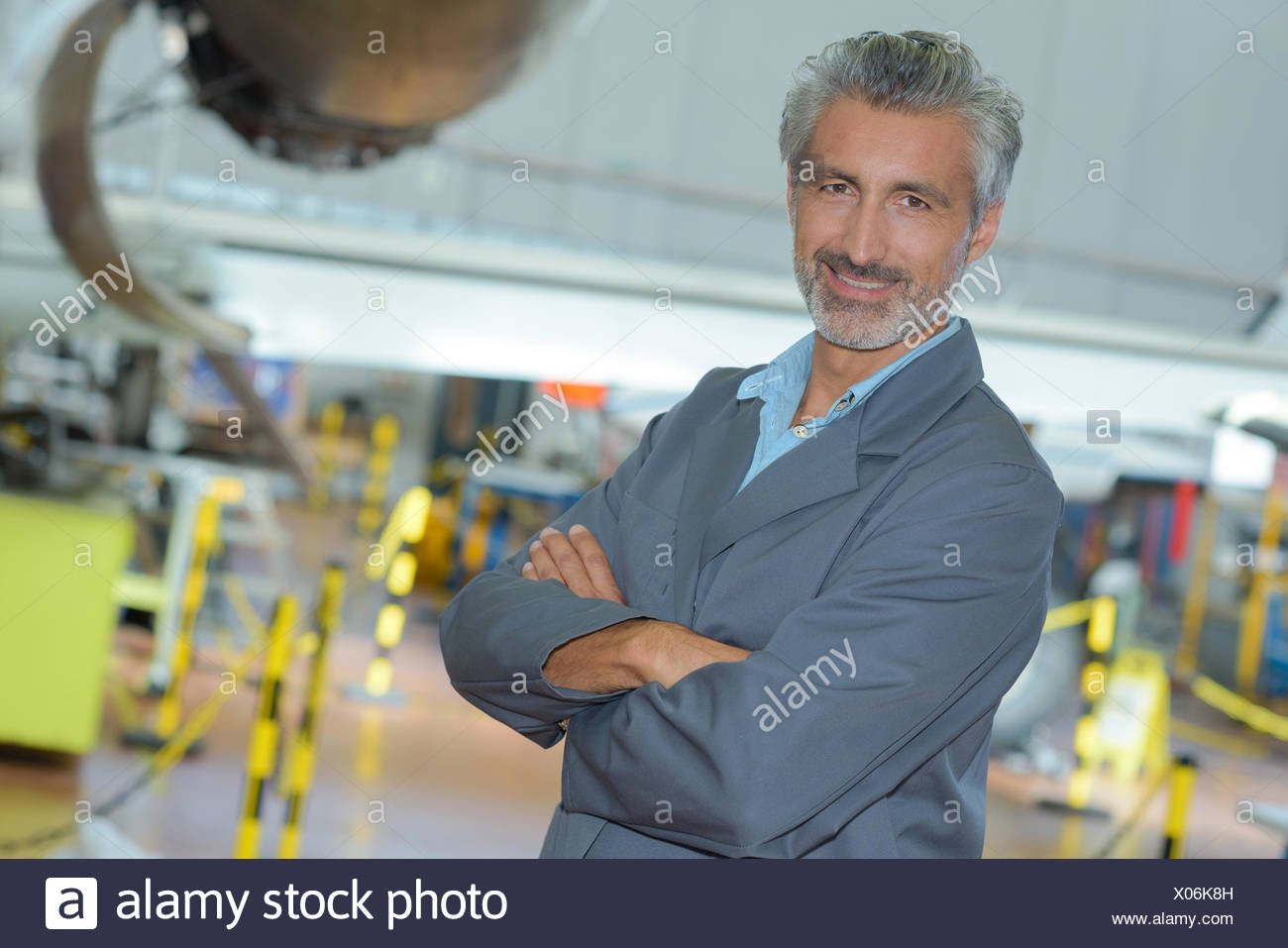 portrait of an aviation engineer in a hangar - Stock Image