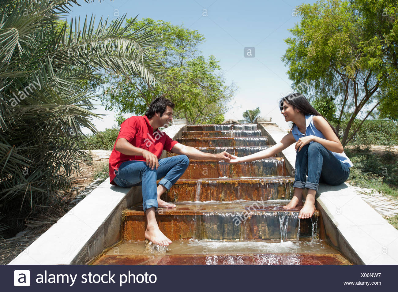 Couple Enjoying At Waterfall In A Park Japanese Park Rohini