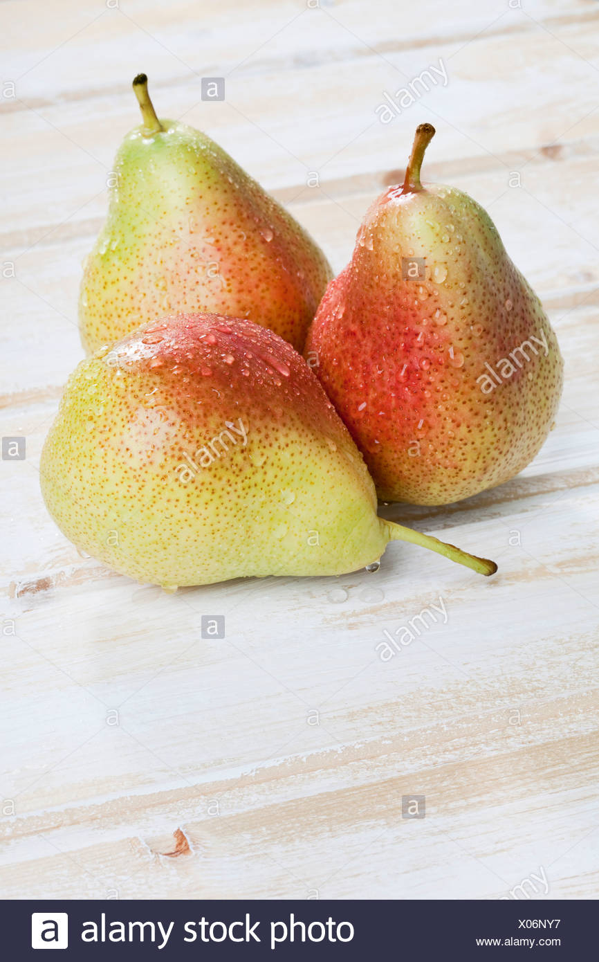 Close up of pears on wooden background - Stock Image
