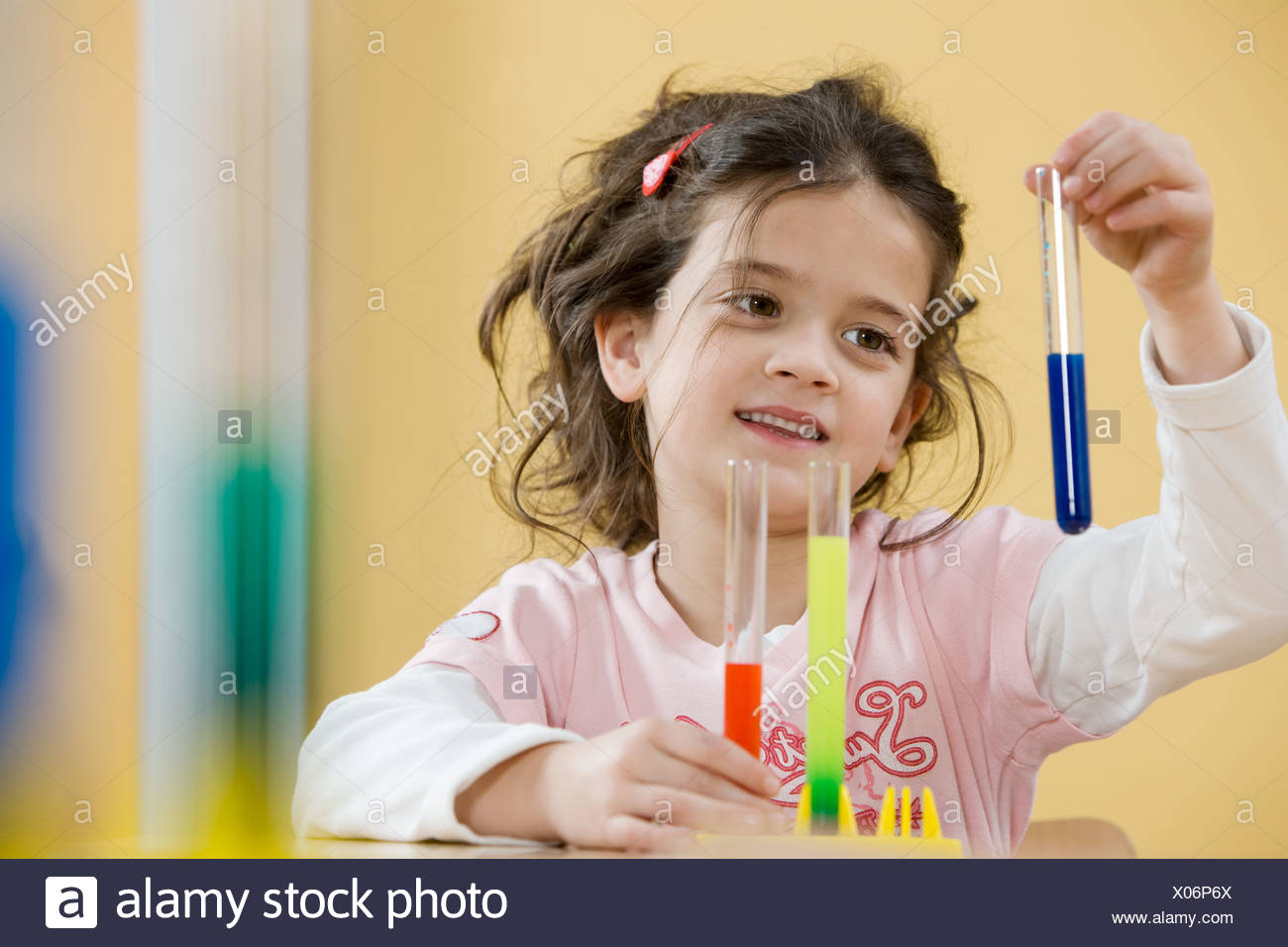 Girl with test tubes - Stock Image