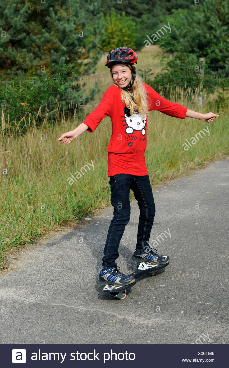 eleven years old girl on a casterboard Stock Photo