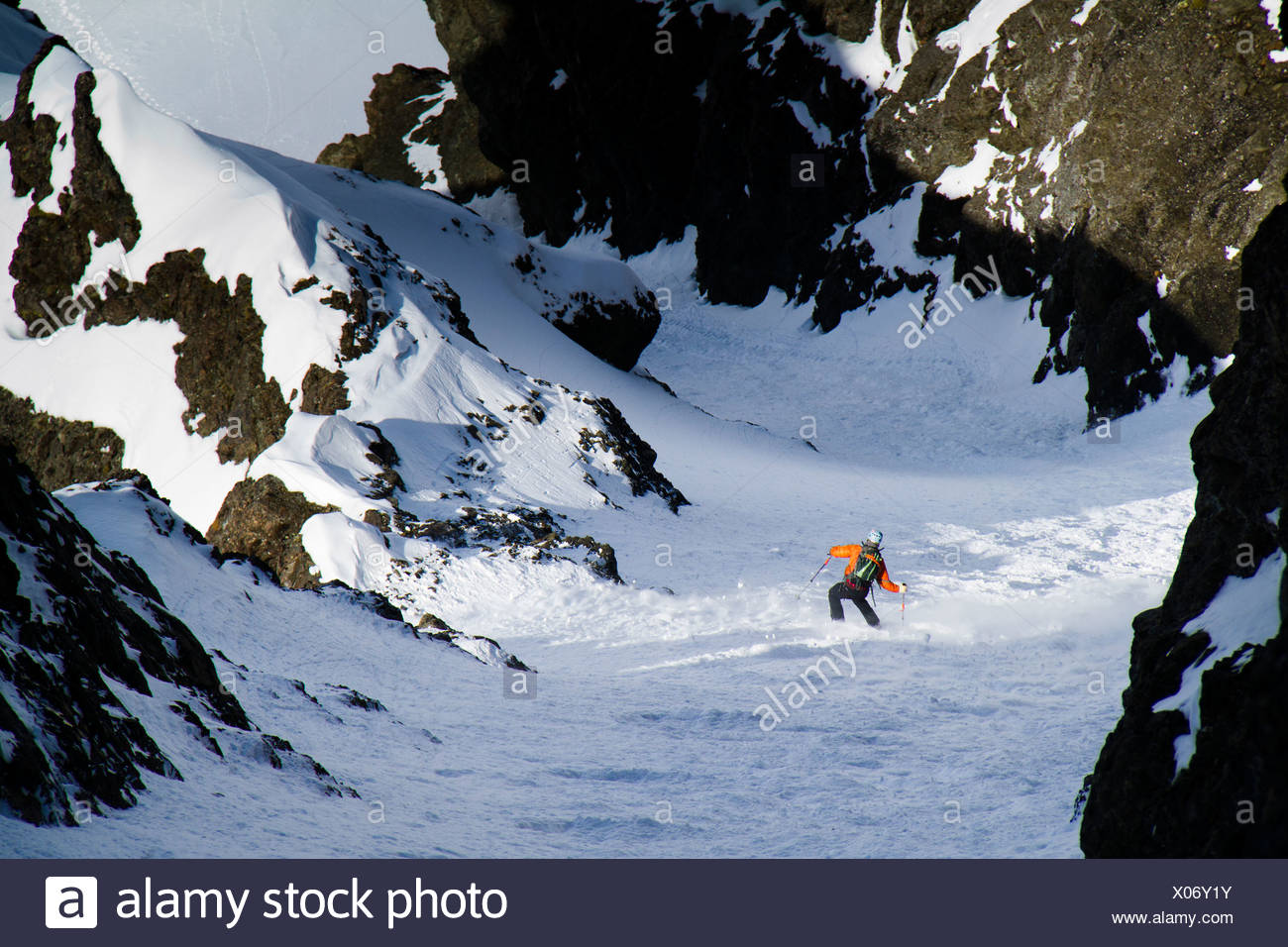 Man backcountry ski mountaineering on the north face of Korohusk Peak in the Ram Valley, Chugach Mountains, Eagle River, Alaska - Stock Image