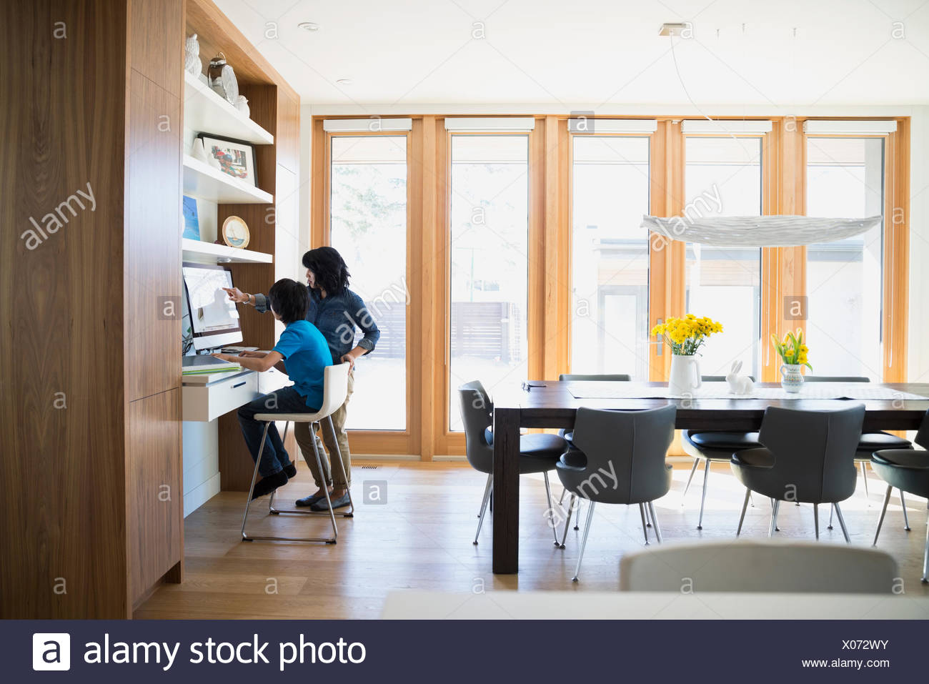 Mother And Son Using Computer Desk Dining Room
