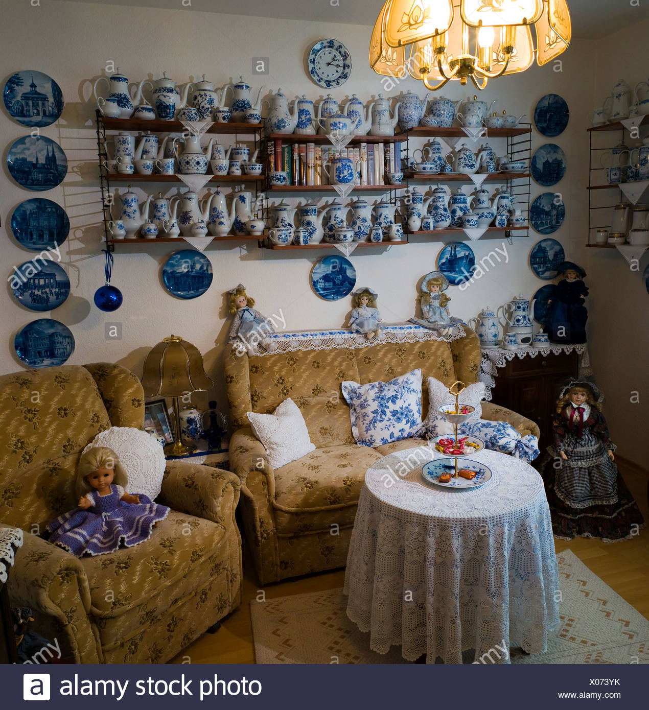 Living room with teapots and dolls, Germany, Europe - Stock Image