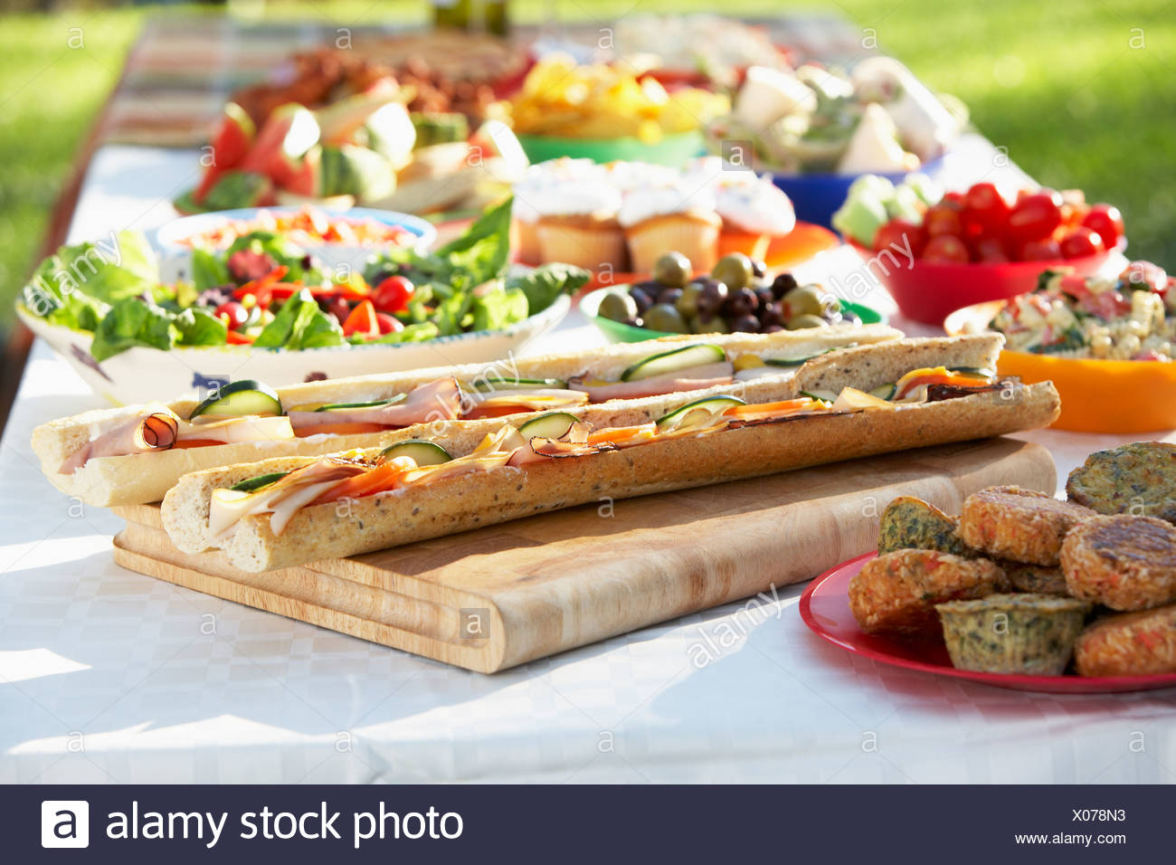Al Fresco Dining, With Food Laid Out On Table - Stock Image