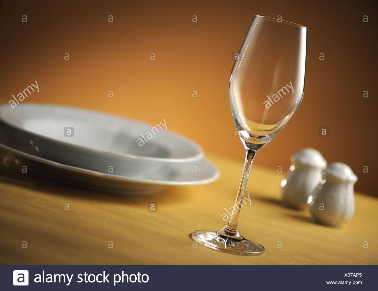glass on table, close up, shallow dof - Stock Image