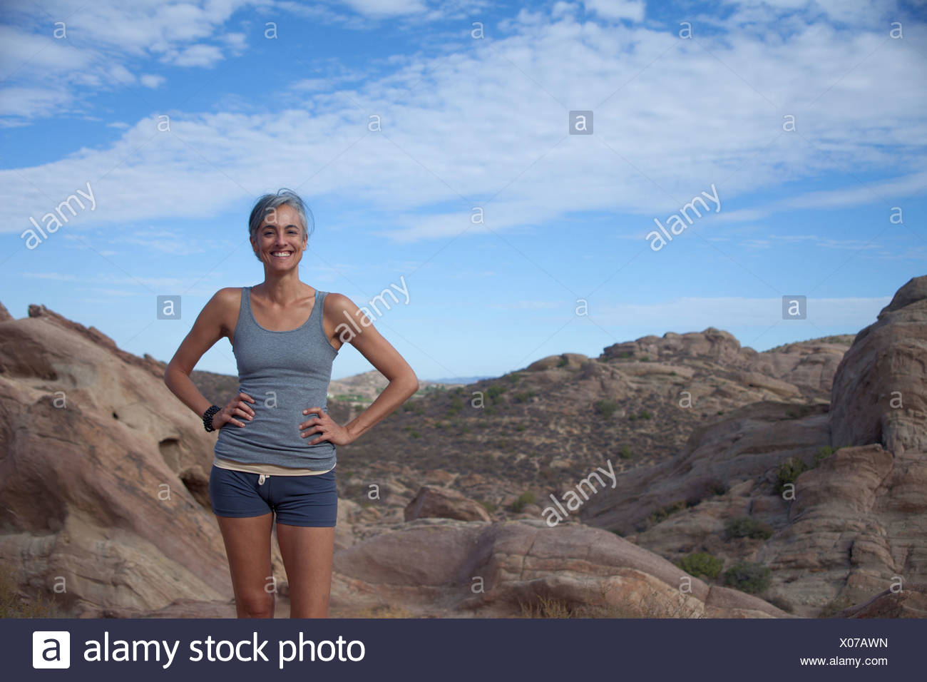 Woman standing at Vazquez Rocks with hands on hips - Stock Image