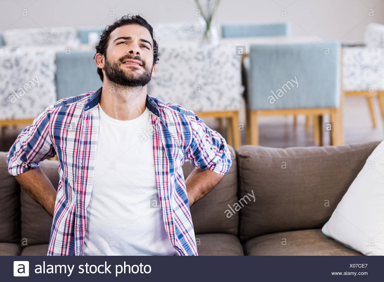 Man with back ache - Stock Image