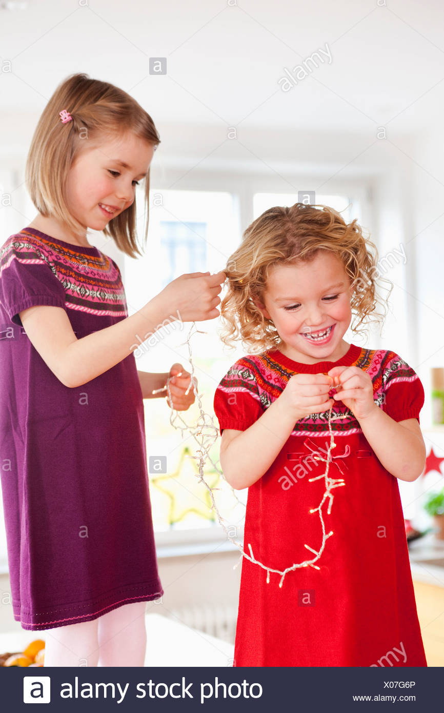 children playing with decoration lights - Stock Image