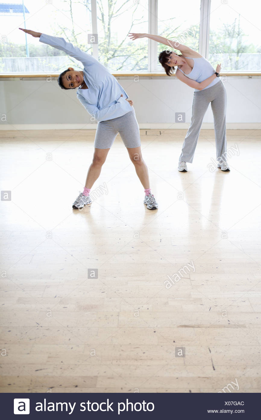 Women stretching in gym - Stock Image