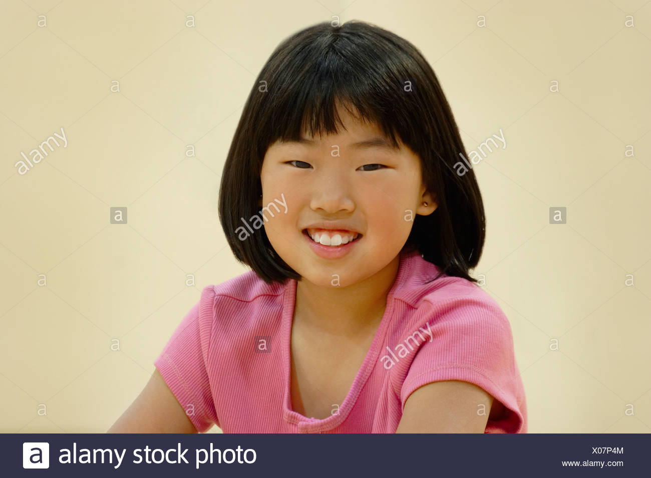 Smiling asian girl - Stock Image
