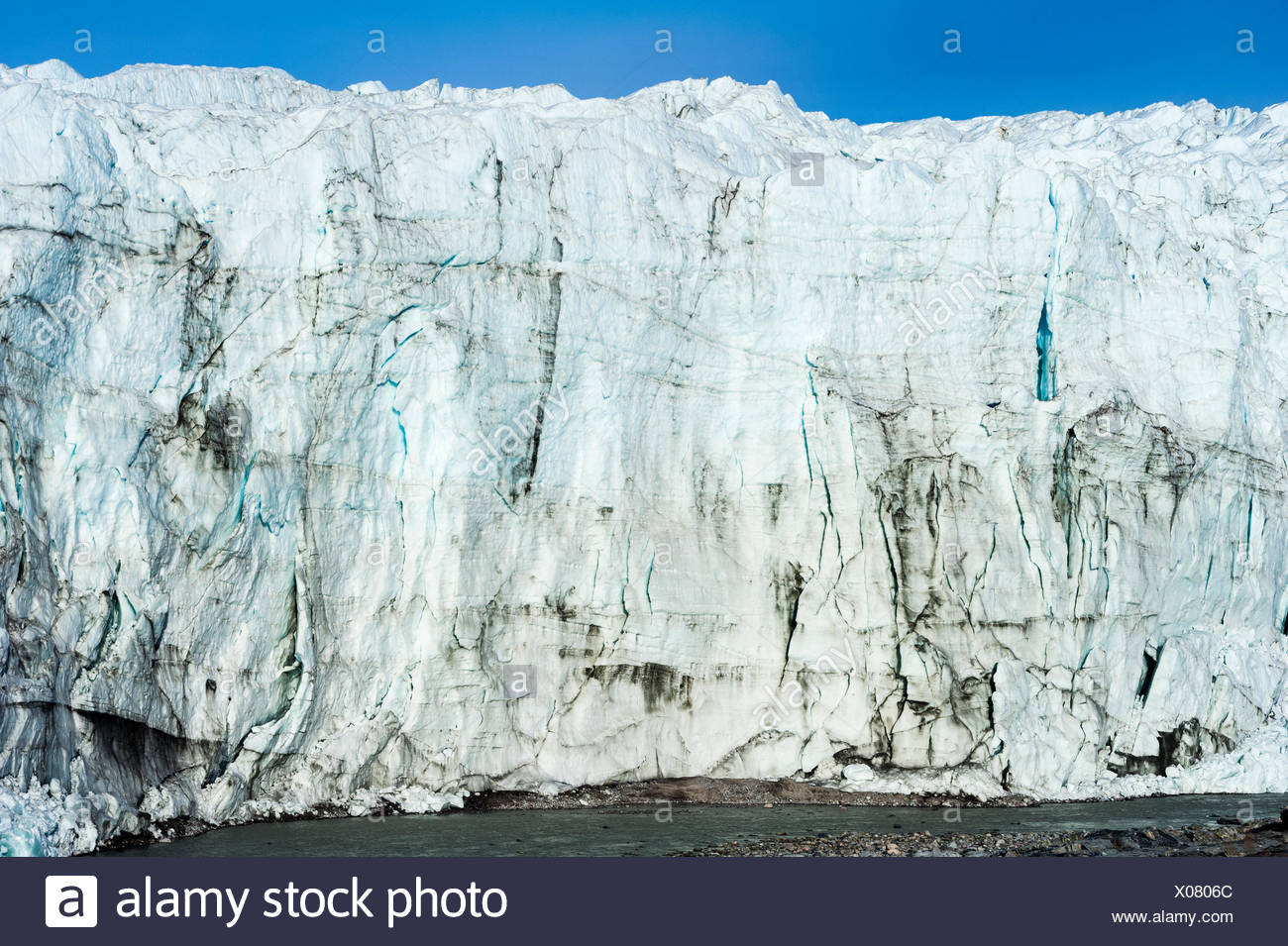 The sheer ice cliff of a glacier fracture zone. - Stock Image