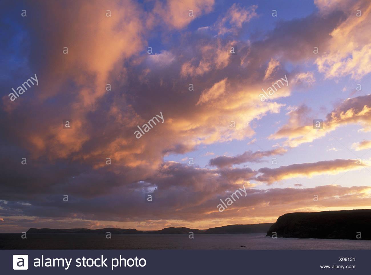St. John's Bay, Cape Spear, Newfoundland, Canada, sky, sunset, clouds, ocean, sea, land, water, coast, - Stock Image