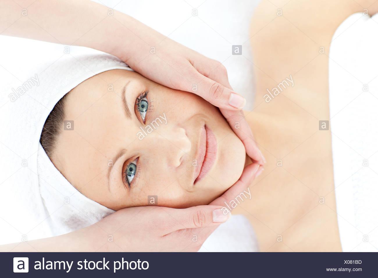 Charming young woman enjoying a facial massage Stock Photo
