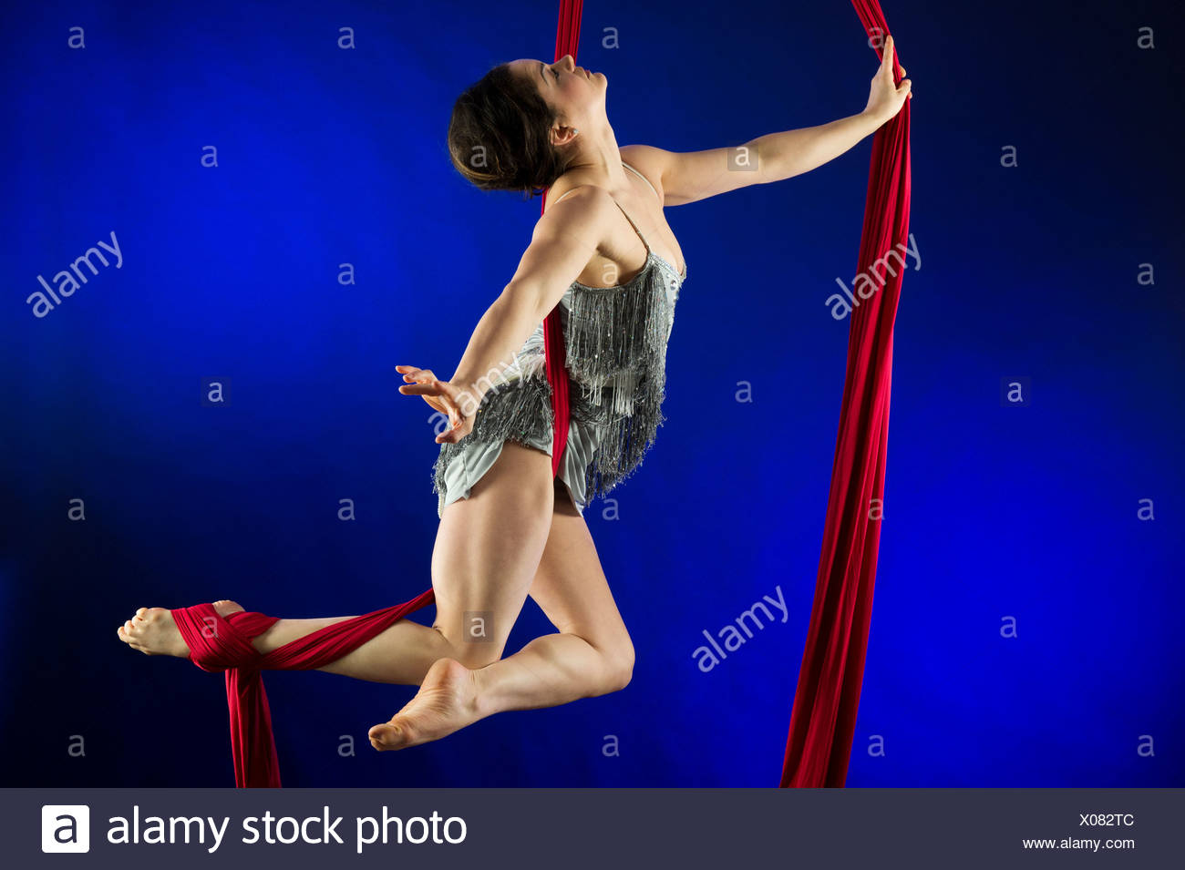 Woman performing acrobatics - Stock Image