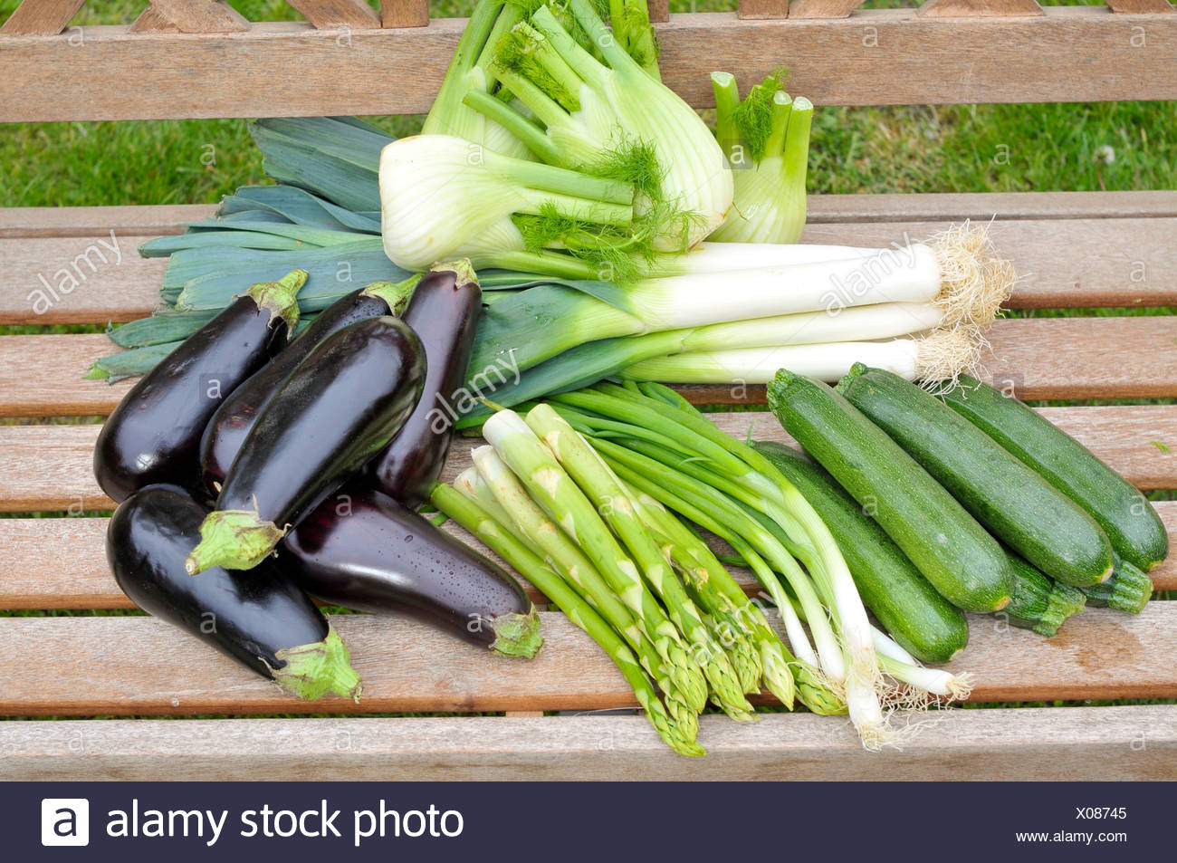 Green asparagus, eggplants, zucchini, spring onions, fennel, leeks Stock Photo
