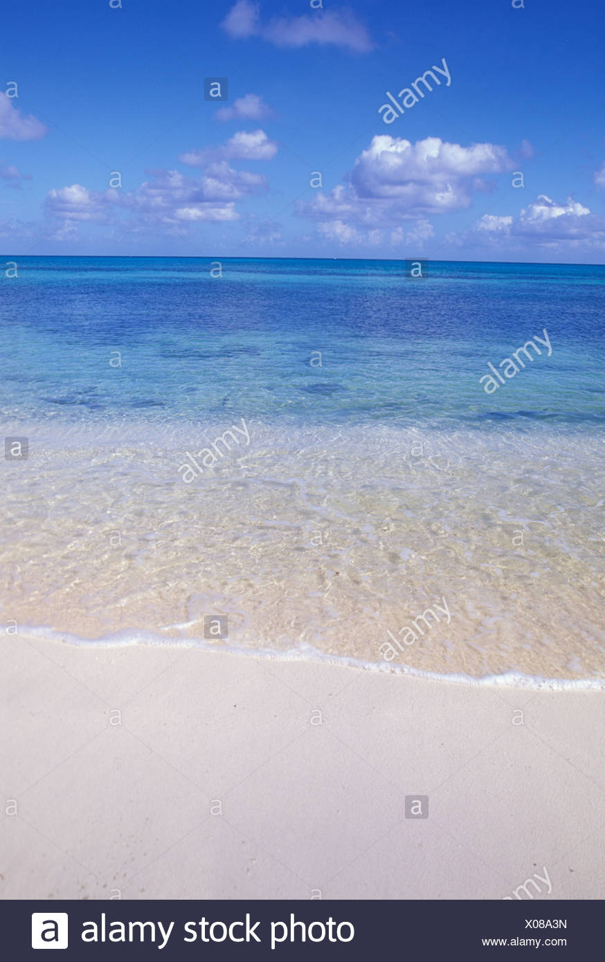 GENTLE WAVES ROLL ONTO THE SHORE TURKS AND CAICOS - Stock Image