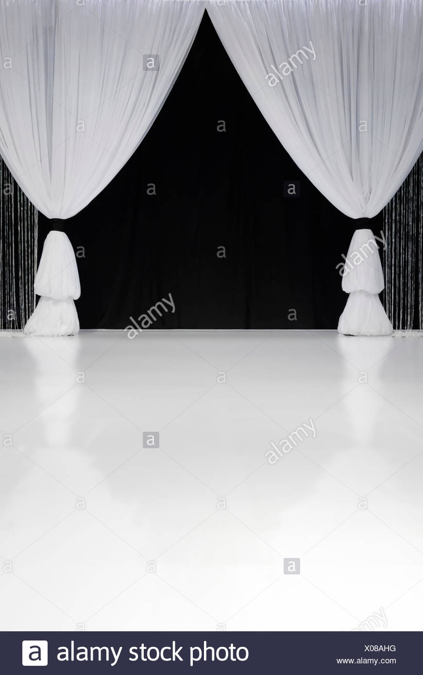 White Stage Curtains In Front Of Black
