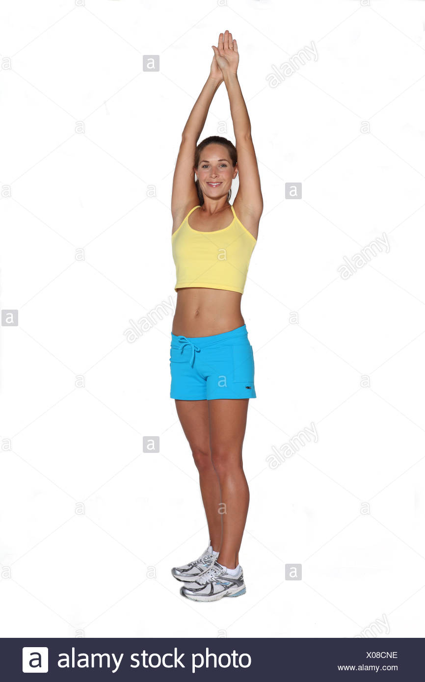 Sun salutation with cross exercise - Stock Image