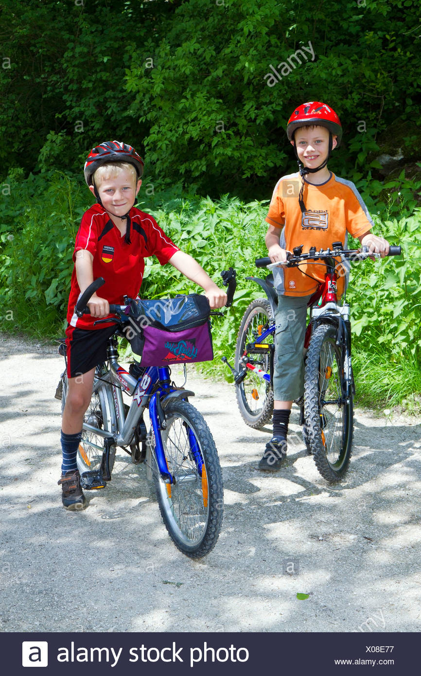 2 boys, 6 and 8 years, on a bicycle tour Stock Photo