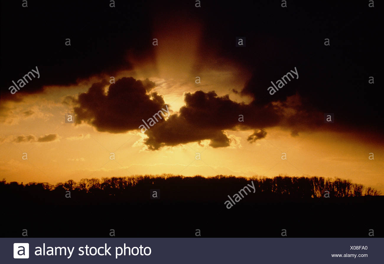 Stormy sunset over rural English countryside. - Stock Image