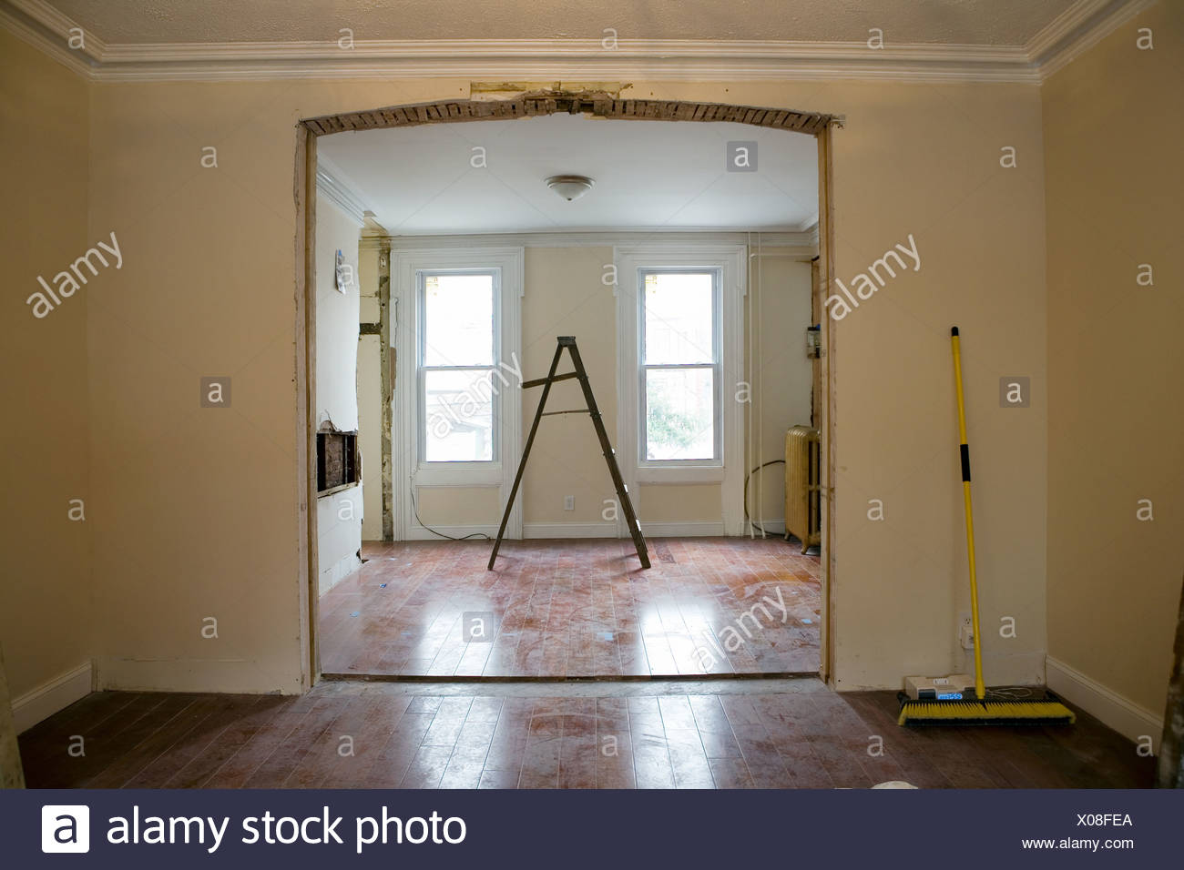 Open plan room with stepladders - Stock Image