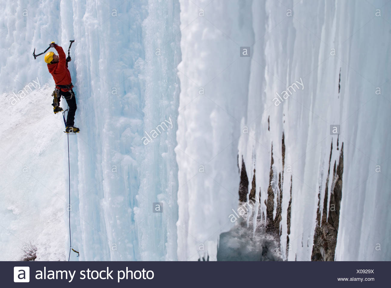 A male ice clmber tackles some steep ice in Johnstone Canyon, Banff National Park, AB - Stock Image