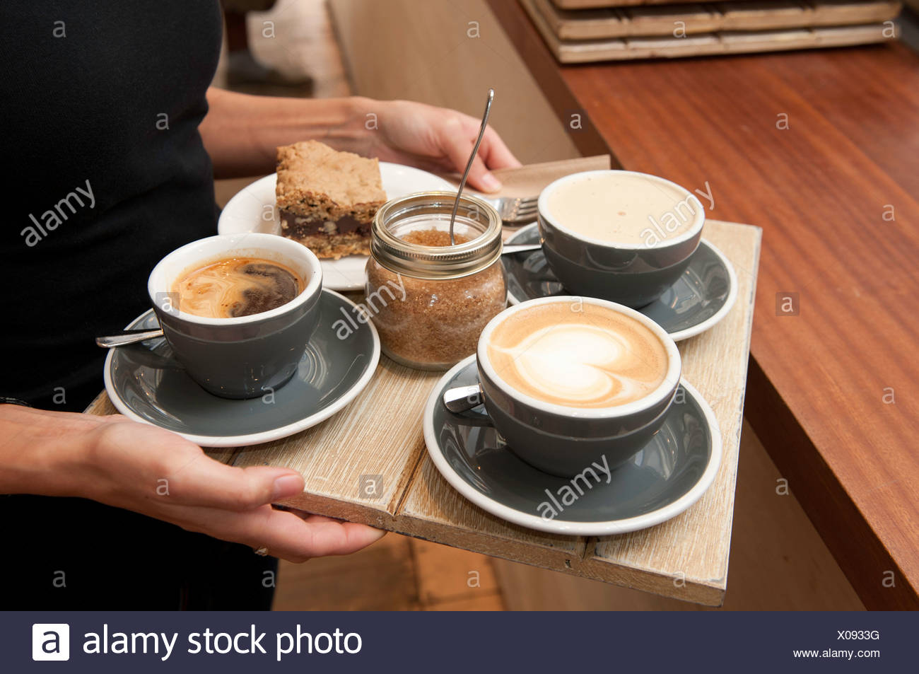 Barista serving coffee - Stock Image